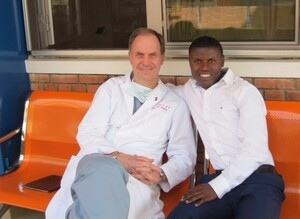 STS Member Dr. Ralph Bolman (USA) with a patient who previously had double valve surgery and is now a medical student in Rwanda. Photo courtesy of Team Heart.