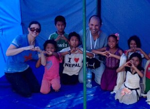 Dr. Farkas poses with children in Nepal