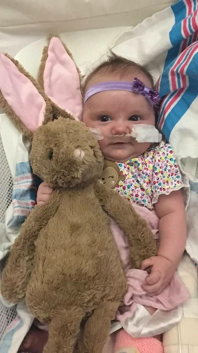 """Liby Peterson with her """"Heart Beat"""" bunny. Just one week before her heart transplant, her original heart's beat was recorded in the bunny. Courtesy photo"""