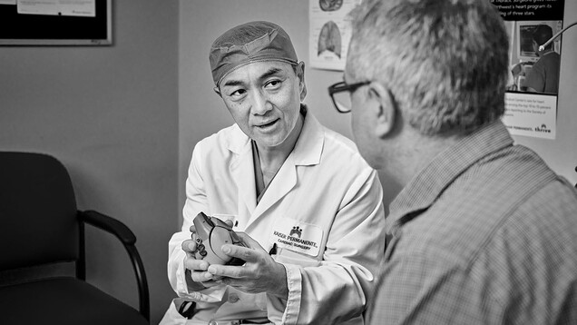 Yong Shin, M.D., of the Kaiser Sunnyside Medical Center in Clackamas, Ore., consults with a patient.