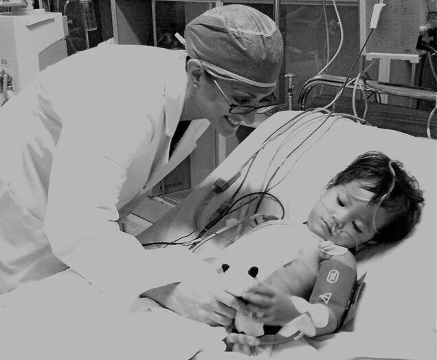 Surgeon with Child