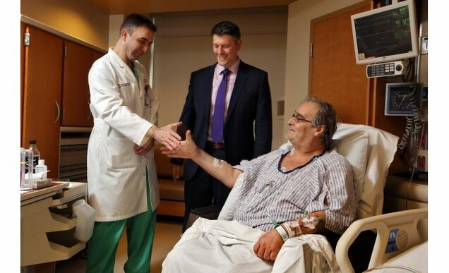 Scott Hamilton visits with members of surgical team Dr. Ashraf El-Hinnawi and Dr. Bryan Whitson (center) who performed the lung-kidney transplant.
