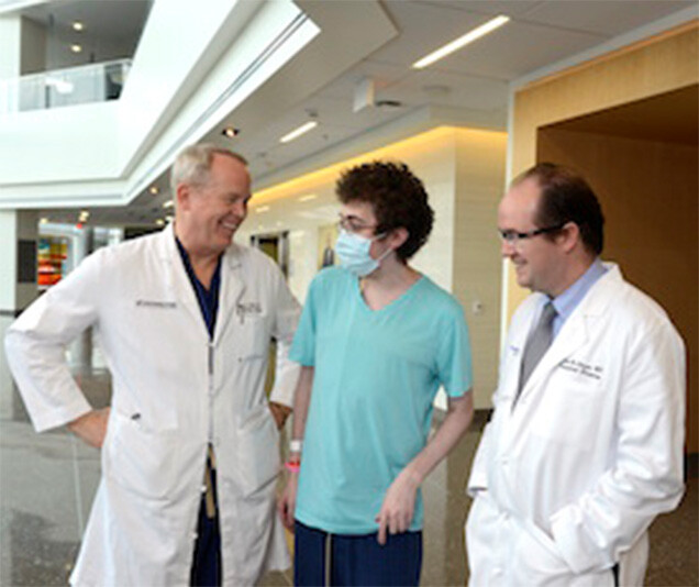 Josiah Ferrell, center, meets with his transplants surgeons, Dr. Michael Wait, left, who performed his lung transplant, and Dr. Malcolm MacConmara, right, who performed the liver transplant.